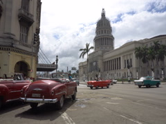 Movement retro cars, local autos and vehicles are riding near ancient colonial Stock Footage