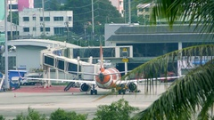 Airbus A320-200 of AirAsia drives along airport terminal Stock Footage