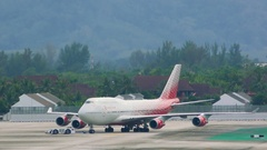 Tow machine move Boeing 747 on taxiway Stock Footage