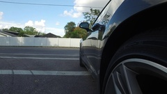Exterior Shot of Car Driving Down Road Stock Footage