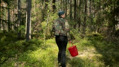 Girl in the khaki jacket looking for mushrooms Stock Footage