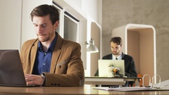 Tired Young Businessman Yawning During Work Stock Footage
