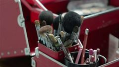 Beautiful make up case with cosmetics and brushes - closeup view Stock Footage