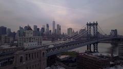Descending aerial shot of New York City seen past Manhattan Bridge Arkistovideo