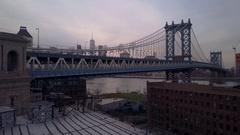 Rising over Manhattan Bridge aerial shot of New York City Arkistovideo