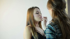 Makeup artist applying lips contour with special crayon Stock Footage