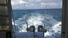 Yachts with fishing tackles sailing in ocean Stock Footage