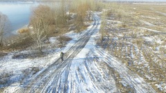 4K Aerial.  Tourist  winter life. Man with  backpack goes  on  frozen road . Stock Footage