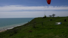 Paragliding Sport On Seashore With Beach Stock Footage
