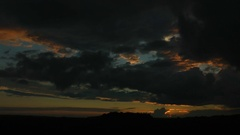 Clouds of black and red and orange color, after a cyclone. Evening, sunset. Stock Footage