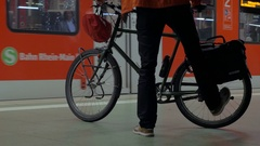 Man with bike waiting for subway train Stock Footage