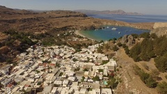 Aerial of flying away from the castle in Lindos (Greece) Stock Footage