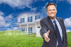 Male Agent Reaching for Hand Shake in Front of Ghosted New House Stock Photos