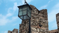 Rectangular lantern with broken glass on the background of blue sky Stock Footage