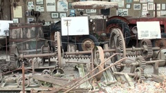 Old rusty gears, barrels, tractors in the covered warehouse Stock Footage