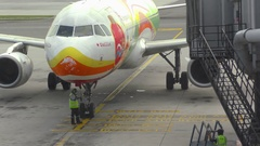 Airplane taxiing ends in the jetbridge Stock Footage