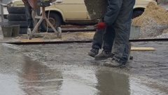 Pouring, Laying Concrete at the Construction Site using Buckets of Cement Stock Footage