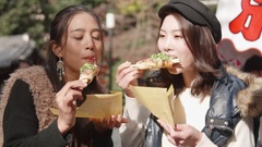 International girls enjoy street food in Kyoto Temple Japan while sightseeing Stock Footage