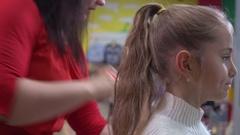 Female child in children beauty salon Stock Footage