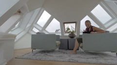 Woman with pad in the room of Cube House Stock Footage