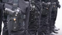Soldier hand in black glove holding automatic machine gun Stock Footage