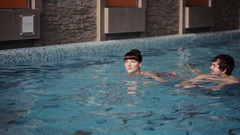 Couple swimming in the pool Stock Footage
