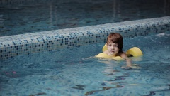 Child swims in the pool Stock Footage
