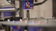 Dairy plant yoghurt packing equipment at work Stock Footage