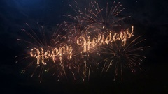 Happy Holidays greeting text with colored slow motion fireworks Stock Footage