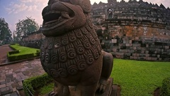 Ancient statues and Buddhist architecture of Borobudur temple monument in Java Stock Footage