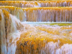 Cascades of waterfall with fluid flowing water running peacefully and calm Arkistovideo