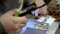 White male setup chips in motherboard smartphone iphone Stock Footage