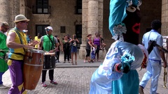 Street performers at the Plaza de Armas. Old Havana, Cuba Stock Footage