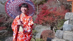 Japanese Kimono women with paracel in Japanese garden Stock Footage