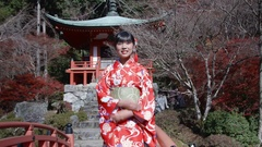 Japanese Kimono women welcomes Tourists to Kyoto infront of Temple Stock Footage