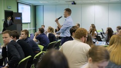 Young professionals gathered to listen to the training in economics. A more Stock Footage