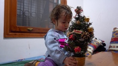 Kid admires his first New Year Tree Stock Footage