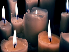 Close up 4K view of wax candles burning quietly in darkness. Abstract background Stock Footage