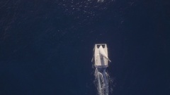 Aerial top view of sailing white yacht in empty ocean blue water, Mauritius Stock Footage