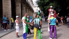 Street performers at the Plaza de Armas. Old Havana, Cuba Stock Footage