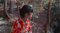 Japanese girl walking through temple gardens steadycam shot Stock Footage