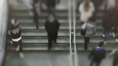 Birds eye view, dolly slow motion, anonymous crowd of people walk subway steps Stock Footage