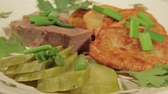 A dish of roasted potatoes with meat Stock Footage
