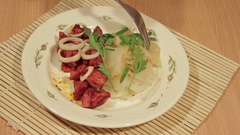 Man eating dish of cabbage with roasted meat Stock Footage