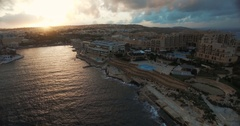 Aerial shot on a cloudy day during sunset in Malta Stock Footage