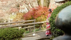 Beauitful Kimono girl walking across bridge in Temple gardens  Stock Footage