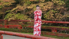 Beautiful red kimono girl welcomes tourists to Kyoto Japan Stock Footage