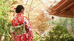 Beautiful Japanese Kimono girl poses in Kyoto Temple setting  Stock Footage