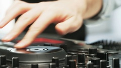 Disc Jockey Using DJ Mixer And Taking Headphones Off Stock Footage