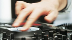 Disc Jockey Using DJ Mixer And Taking Headphones Off Arkistovideo